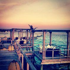 Sunset over the over water restaurant in Jumeirah Vittaveli Maldives