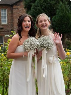 Bridesmaids' bouquets - full babys breath and dusty miller bouquets wrapped in twine with stems showing