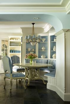 Cabinets provide room divider for beautiful dining area. light blue and white. Oak Hill Architects, Boston