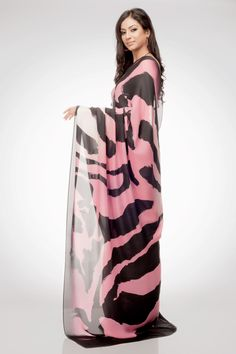 A stylish saree with awe-inspiring print depicted graphically, the bold cheetah dots at the base and beautifully scattered tiger prints accentuates the royal charm for a trendy wardrobe. Complimented with a crepe blouse, Drape it for a stunner afternoon.Shop online at www.satyapaul.com and Join our facebook page at www.facebook.com/SatyaPaulIndia