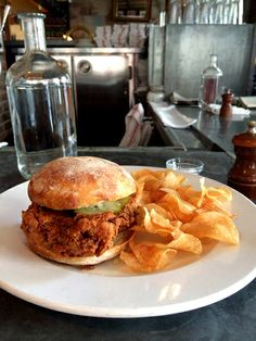 Country fried chicken sandwich with honey, tabasco, mayo, pickles and chives served with chips is superbly worth checking out. Photo by Donny Tsang