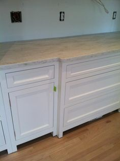 square cut corian counter top in sea salt- without a bullnose edge it looks like granite.
