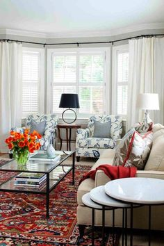 "How to mix Oriental rug with modern furniture furnishings. Essentially, make sure some color from rug is ""lifted"" and repeated in room accessories. The rug colors become the theme colors of the room. rhttp://www.blulabelbungalow.com/2014/10/modern-decorating-with-oriental-rugs.html"