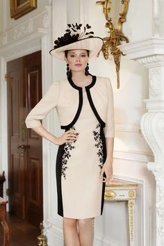 Like the idea of slimming black side panels and applique lace to soften the line.Condici Spring 2013 Style 70766