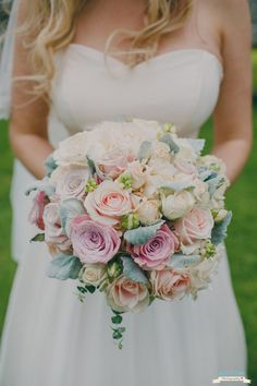 A blush, pink and white bouquet from one our our Country Flower Company brides with touches of soft grey dusty miller and eucalyptus baby blue.