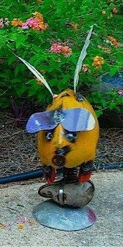 """Flying Pig garden sculpture is unique metal yard art and delightful decor anywhere in the landscape. Handmade in Mexico, vibrant color & fun design, 18"""" tall"""