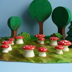 wooden fairy ring: Use old wooden drawer knobs for toadstools in Kids fairy gardens