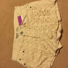 Ivory high waist , high rise crochet panel shorts These have a ivory crochet panel over and plain on back with two back pockets. Body is 98% cotton , 2% spandex . Crochet is 200% cotton .has a tag on waist . Mossimo Supply Co. Jeans