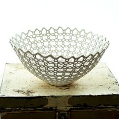 Oh my god this is amazing. Carved Porcelain Fruit Bowl. $3,400.00, via Etsy.