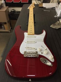 G&L Musical Instruments Here's an S-500 in Clear Red over swamp ash, 3-ply white guard, white covers and knobs, maple neck with Vintage Tint Satin finish.