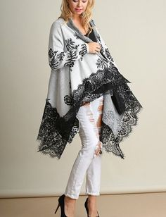 60% Cotton, 40% Polyester. This is a beautiful, open front cardigan sweater. It has a medium weight to it, long sleeves with a floral pattern. Asymmetrical hem with a 10 wide band of lace sewn at the hem line. Sleeves are traditionally fit. ( not loose or baggy in the sleeve) The body is loose and flowing. Just gorgeous. The Center Back length is approx. 35 inches.
