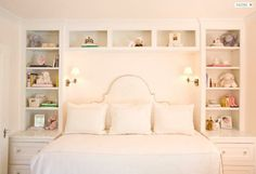 Another gorgeous built in daybed with wrap around, floor to ceiling shelving and perfectly placed lighting.  For the girl's room in the future?