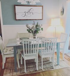 Cottage styled kitchen with headboard. Annie Sloan chalk painted table and chairs... old white and duck egg blue. #smallwoodhome gather sign. Farmhouse style