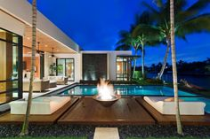 Fronting 100 feet along the Intracoastal Waterway, this modern Boca Raton, Florida, home brings the outdoors in. Glass walls offer prime waterfront views, with the living areas and master retreat opening to the small infinity-edge pool. The home's front courtyard has an ipe walkway crossing over a reflecting pond.