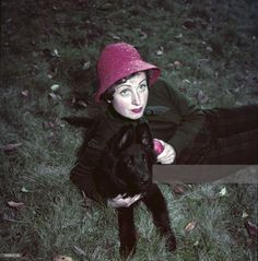 0 french actress Danielle Darrieux with her dog in her garden in Feucherolles, France,  1950