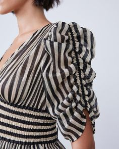 Details of our deep-v gold and black striped Lara blouse up close 🖤 complete with ruched sleeves and a low deep-V for a flirty, subtle look. Kurti Sleeves Design, Sleeves Designs For Dresses, Sleeve Designs, Dresses With Sleeves, Stylish Blouse Design, Stylish Dress Designs, Stylish Dresses, Stylish Dress Book, Sari Blouse Designs