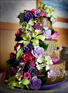 Chocolate cake with green icing and pink and purple flowers - Photo by Kara