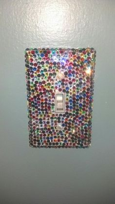 A mini-gem covered lightswitch plate for a teenage girl's bedroom. Similar lightswitch covers are now available for purchase through my Facebook store, Dazzled Decor.