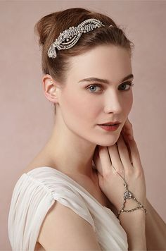 This 20's-inspired piece features crystals, pearls, and silver leaves swirled together in a fluid design. BHLDN, Spring 2014