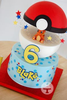 Pokémon Pokéball cake for Blake, with Charmander.