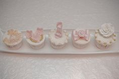 Lovely row of pastel cupcakes by Cupcakes By Chrissie