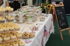 Love the bunting, board and layout of teacups.