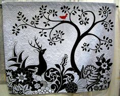 """Black & White deer with red bird quilt    """"Moon Garden"""" by Judy Coates Perez    Her blog is here: judyperez.blogspot.com/    Her book """"Painted Threads, Mixed Media Textile Art"""", featuring this quilt along with her other textile arts, is available here: www.blurb.com/bookstore/detail/935831/?utm_source=badge&a..."""