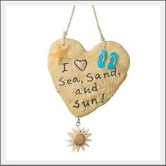 Sea, Sand, Sun ornament. Let it sun! Let it sun! Let it sun! Proclaim your love of all things Sea, Sand and Sun this Christmas season. Our resin beach ornament was designed in a textural sand style finish. I heart sea, sand and sun!