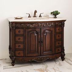 The 48″ Provincial Dark Single Bathroom Vanity is built on a high-grade solid mahogany frame. This vanity is built to last a lifetime and brings with it a sharp sense of sophistication. Behind its eight drawers and double door cabinet, you will be surprised just how much space this medium-sized vanity contains.  The Provincial Vanity is outfitted with a luscious Ivory Cream Marble Countertop which adds a beautiful contrast to the darker tones of the cabinet. $3,990.00.