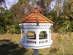 Gazebo Bird Feeder Plan - this site has woodworking plans for these and garden swings.