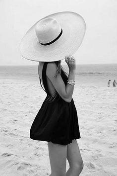 black mini with large straw hat