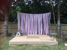 Perfect #garden #wedding #homemade stage, ribbon curtain, huge #haybale sofa & #vintage decor. Congrats Grace & Emma