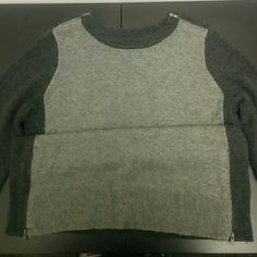Military Inspired Zippered sweater Edgy wool sweater with zippered shoulders and zippers at the waist on both sides. Dark gray back and sleeves, light gray front. Worn once and dry cleaned after. J. Crew Sweaters Crew & Scoop Necks