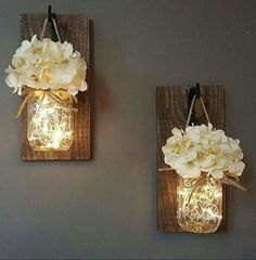 HANGING MASON JAR SCONCES....with Lights! LOVE this idea...so pretty! Don't you think?  You can find them here (affiliate)... http://rstyle.me/n/bzem3rb5zc7 .