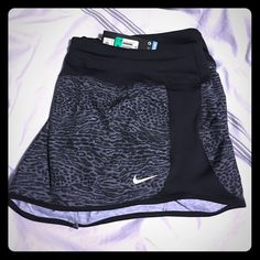 NWT Nike Dri-fit running shorts NWT grey & black leopard print NIKE Dri-fit running short.  Elastic waist with drawstring tie & attached panty. Nike Shorts