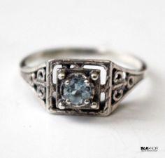 BLK AND NOIR JEWELRY  1920s Art Deco Edwardian Ring(http://www.blkandnoir.com/aquamarine-stone-1920s-art-deco-edwardian-ring/)