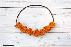 So+perfect+for+fall!+This+whimsical+pumpkin+spice+flower+crown+is+handmade+with+a+wool+blend+felt,+each+rose+is+1+inches+wide+and+placed+on+brown+skinny+elastic,+and+the+headband+is+complete+with+dainty+green+leaf+accents.+    Hint+-+It+also+looks+super+cute+double+wrapped+around+a+bun!    Orders...
