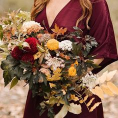 Moody textured earthtone organic wild fall autumn bouquet for an outdoor wedding in Nashville, TN. Burgundy copper yellow rust and peach flowers and foliage for this fall bouquet.