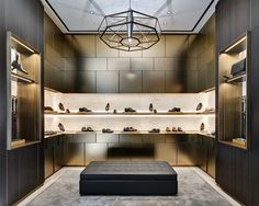 The new Brioni Concept Store worldwide, designed by Park Associati in collaboration with the creative director of Brioni , Brendan Mullane, declines the classic masculine elegance of the brand through a language , taking inspiration from the great master Shoe Store Design, Retail Store Design, Shoe Shop, Retail Stores, Commercial Design, Commercial Interiors, Store Concept, Leather Store, Luxury Store