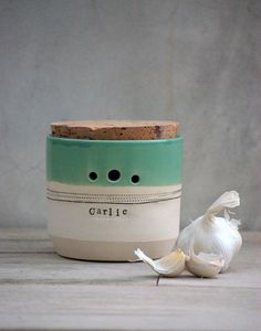 For Sale on Etsy -- Inspiration Handmade kitchen containers; wheel thrown, glaze with a raw bottom and a cork topper. Check out the store for flour, sugar, and salt jars.