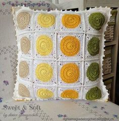 I like the idea of doing the circle pattern on a cushion but mixing up the colours so that they match diagonally.