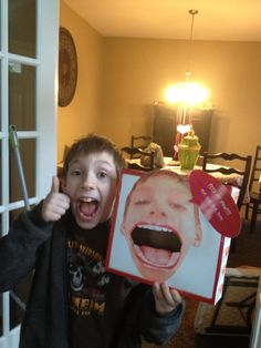 Valentine's Day Box,  Take picture of child with mouth wide open and find a picture of a large mouth opened wide on computer- Cut out the mouth and cut hole part to put Valentine's Day cards into box.