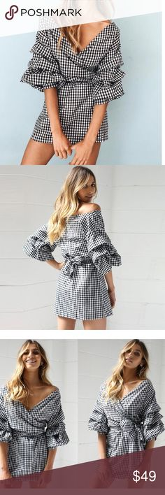Mia Black & White Gingham Wrap Dress New Boutique Item. The Mia Dress is so flattering! It comes in black + white and features a wrap silhouette, tie waist, ruched ruffle sleeves, gingham print, and can be worn multiple ways! The tie at the waist can be tied in the front or the back! The dress can also be worn off the shoulder! Pair with a straw bag, oval sunnies, and espadrilles for that summer chic look! Material: Cotton Poly Color(s): Black/White Handwash Imported Small Size 0-2, Med…