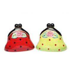 Appletree Design Sugar High Social Purse Salt and Pepper Set, 2-1/2-Inch by Appletree Design inc. $7.68. Comes gift boxed, will make a great gift for yourself or someone special. Ceramic and dolamite material. constructed with quality and durability in mind.. Unique and colorful, add fun and whimsy to your kitchen and home décor. Hand wash only, do not put in dishwasher. Functional and decorative salt and pepper set. Appletree Design is noted for its collection of ...