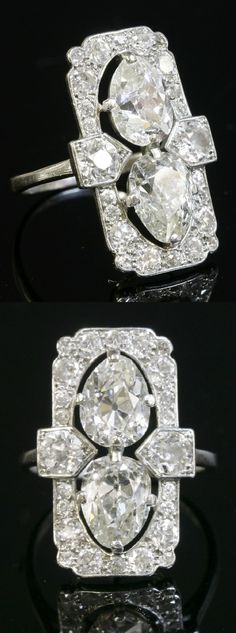 An Art Deco platinum and diamond ring, circa 1925. Of rectangular portrait form, the two old pear cut diamonds claw set end to end, within an outer frame of graduated old European cut and Swiss cut diamonds. Diamond set obus collets to each shoulder to a plain shank. #ArtDeci