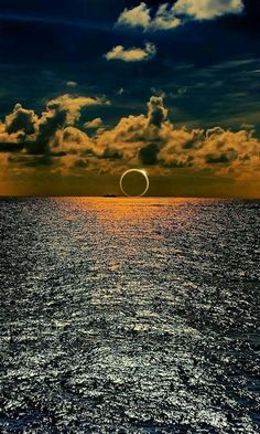 An image purportedly showing the solar eclipse over the South Pacific Ocean is a digitally-manipulated fake. The photo is actually a digital composite of an eclipse and a sunset—both of which are c… All Nature, Amazing Nature, Beautiful Moon, Beautiful World, Pretty Pictures, Cool Photos, Random Pictures, Amazing Photos, Funny Pictures