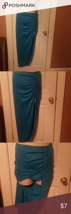 Asymetrical Curtain Skirt Bluish colored asymetrical rouched skirt with a split on the side...skirt is a maxi skirt with a mini skirt underneath..even tho it looks like a top in pic #5, it isn't..it was jus pulled all the way up to see underneath...nwot..size XL tag, but fits a size 14..plenty of stretch.. Skirts Asymmetrical