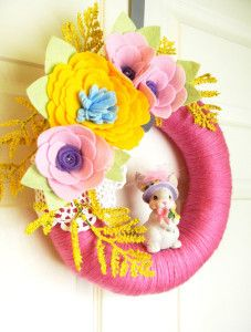 Bright and happy felt and flowers yarn wreath with a bunny, source unknown.