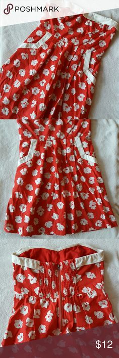 Urban Outfitters red strapless dress Vintage style red strapless dress with white flowers. Two pockets on the front and a zipper in the back. Urban Outfitters Dresses