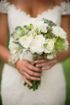 I like the size of this. I don't want a huge bouquet. I want one on the smaller side.  White and green bridal bouquet.